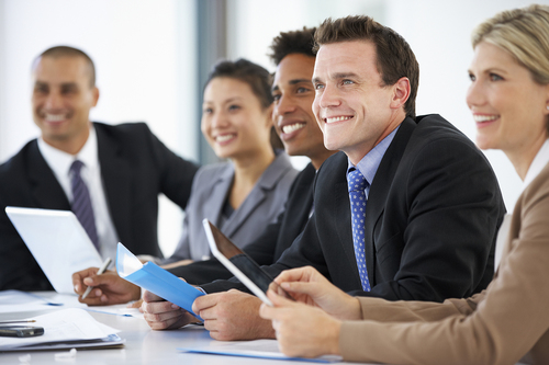 bigstock-Group-Of-Business-People-Liste-92547644