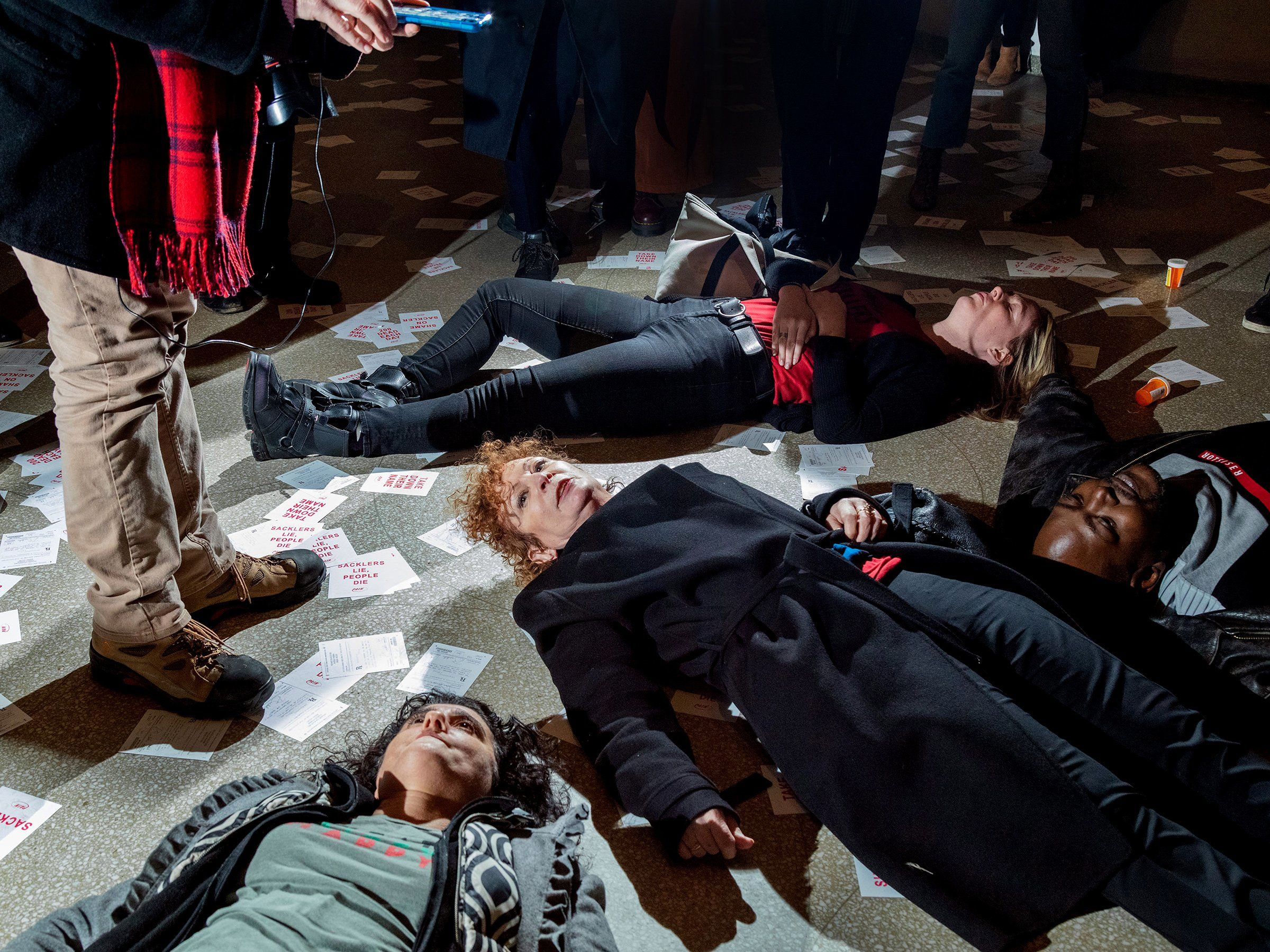 Nan Goldin leads a die-in demonstration against the Sackler family at the Guggenheim Museum in New York in February.