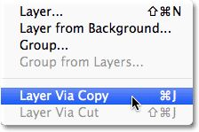 Selecting the New Layer via Copy command from the Layer menu. Image © 2012 Photoshop Essentials.com