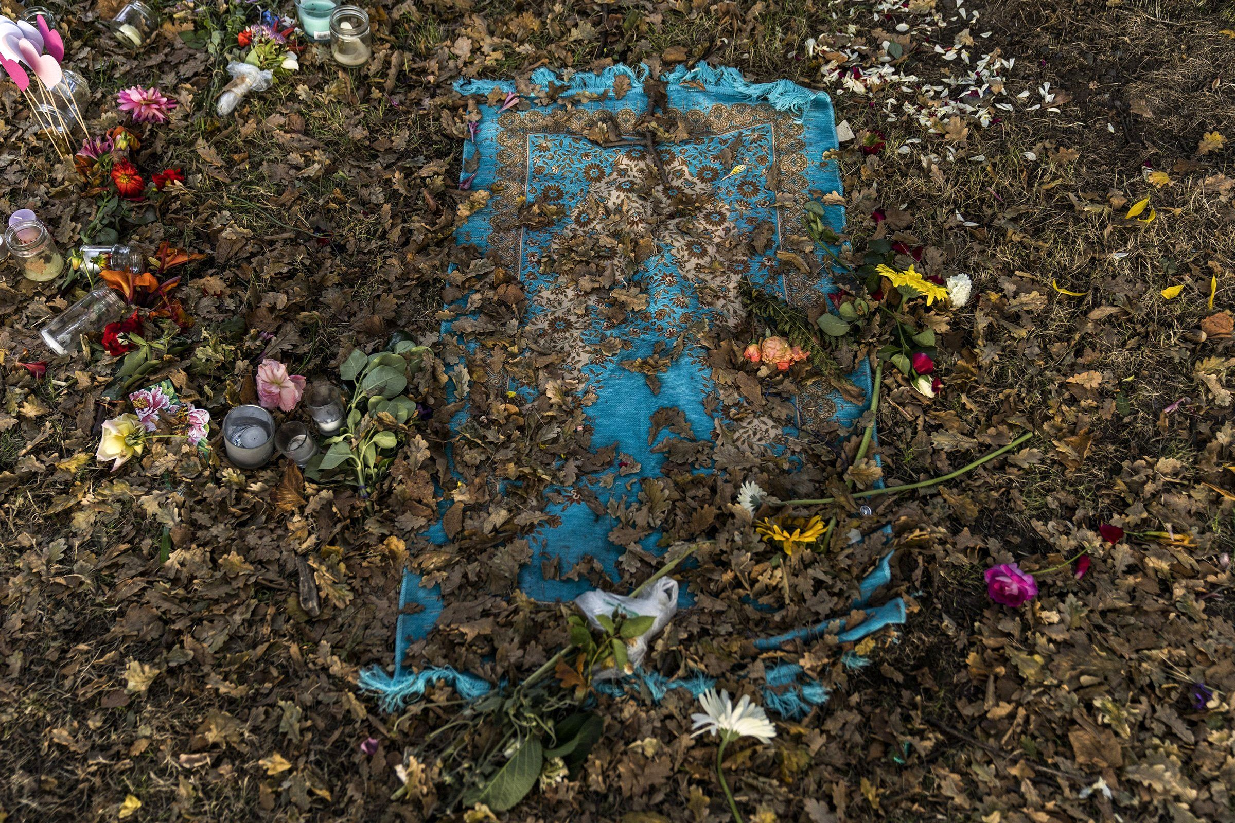 A prayer mat is seen amongst flowers and other tributes at the remains of a makeshift memorial outside the Al Noor Mosque in Christchurch, New Zealand, on March 20. Five days earlier, a far-right extremist massacred 50 worshippers in two mosques.