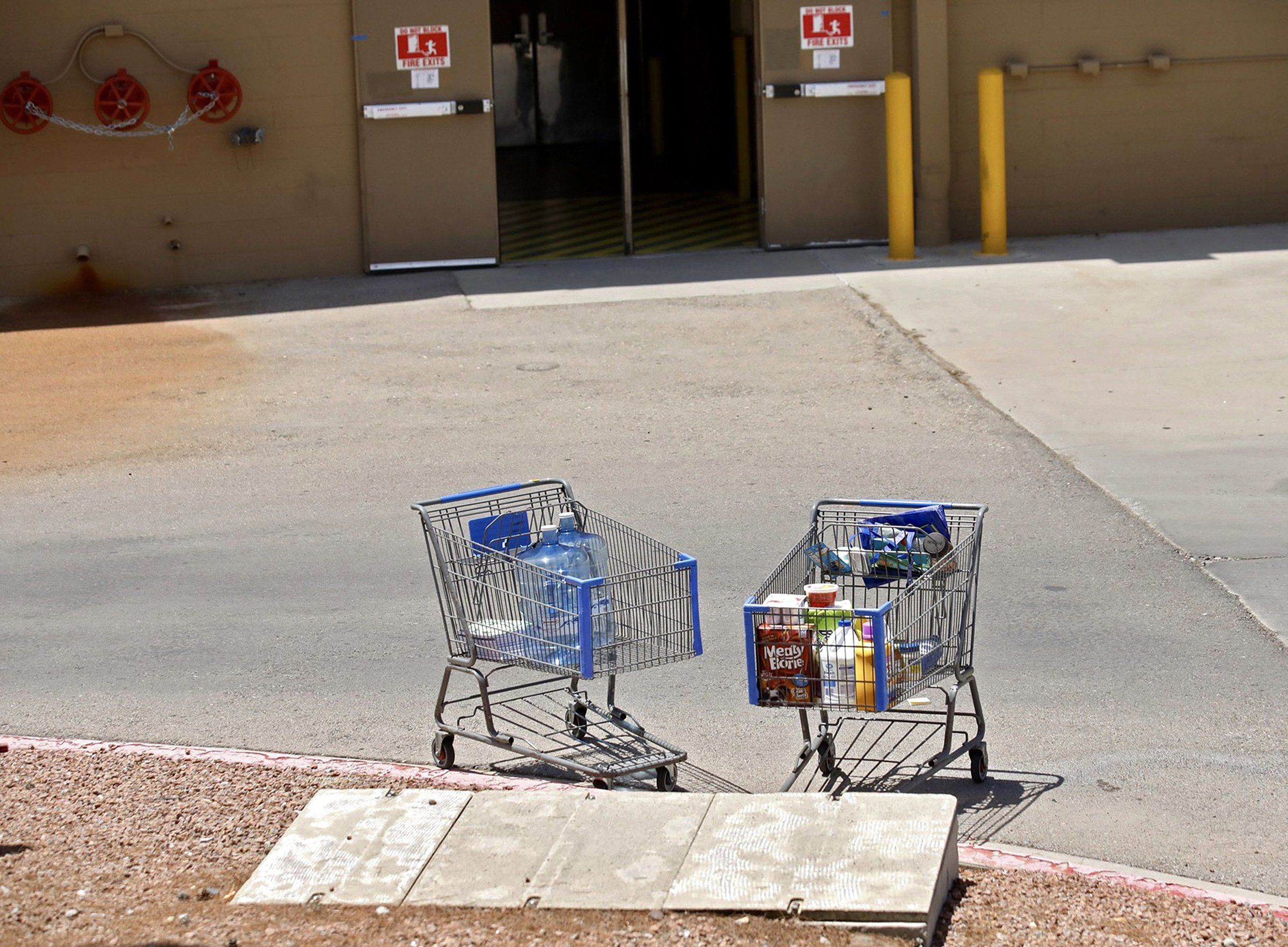 Shopping carts sit next to a curb after the mass shooting at a Walmart in El Paso on Aug. 3.
