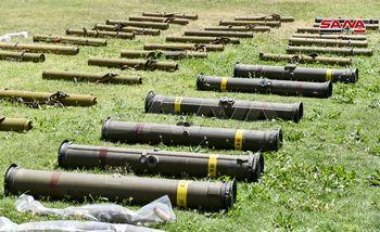 کشف تسلیحات ساخت رژیم اسرائیل و آمریکا از مقر تروریستها در سوریه +فیلم و عکس