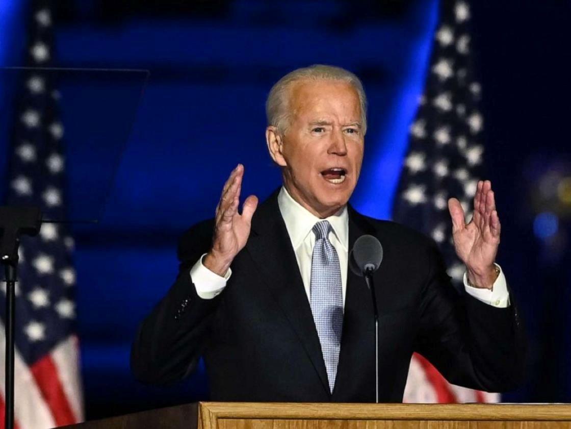 Joe Biden wearing a suit and tie: President-elect Joe Biden delivers remarks in Wilmington, Del., on Nov. 7, 2020.