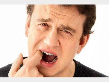 نشانه های مشکلات گوارشی در دهان