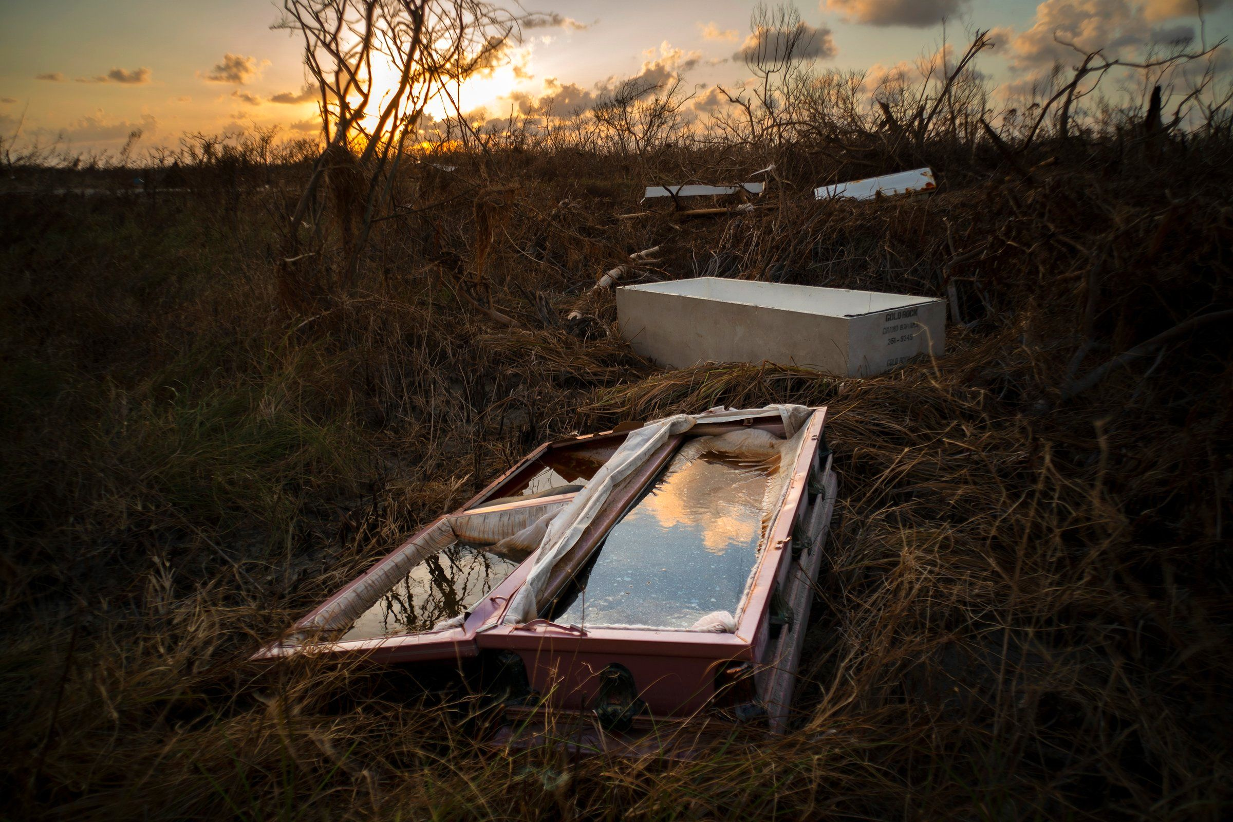 When Hurricane Dorian tore into the Bahamas in September, it settled in. Forecasters watched as the Category 5 storm hovered for days over Grand Bahama, with its winds reaching 185 m.p.h. and a storm surge 25 ft. high. Coffins, like this one at a cemetery in McLean's Town, were lifted out of the earth. The damage left behind was staggering, estimated at some $3.4 billion.