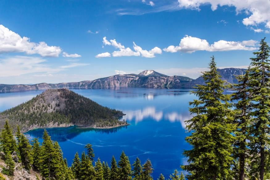Slide 6 of 21: Looking for those spectacular blue hues a little closer to home? You'll be blown away by Oregon's own Crater Lake. In the heart of the Cascade Mountains in Southern Oregon, Crater Lake National Park is an incredible traveler's paradise, but its namesake, Crater Lake is definitely the crowning jewel. This beautiful lake can often be covered by clouds so be sure to check out one of the live webcams of Crater Lakebefore you start hiking out to know what conditions will be like. Love watching wildlife through live cams? You'll love these animal cams from zoos and aquariums around the world.