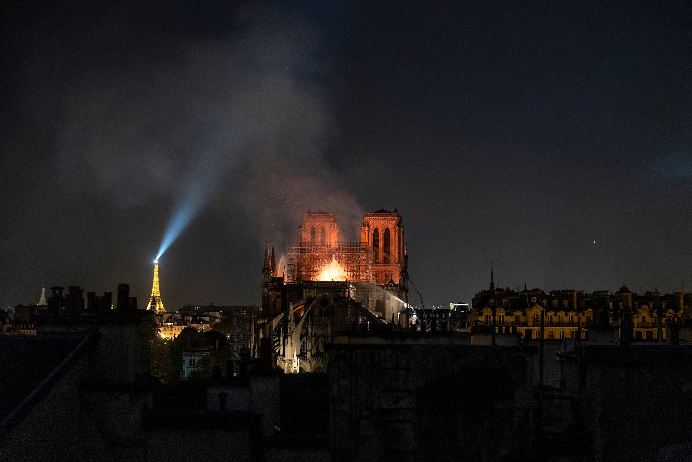 Smoke and flames rise from Notre Dame in Paris on April 15. The city was in flames months before the blaze at the cathedral. Protesters enraged over President Emmanuel Macron's economic plans had smashed storefronts and vandalized ATMs. But the smoke that filled the sky that day seemed to give the beleaguered city a sense of unity. Soon, another took hold: how to rebuild?