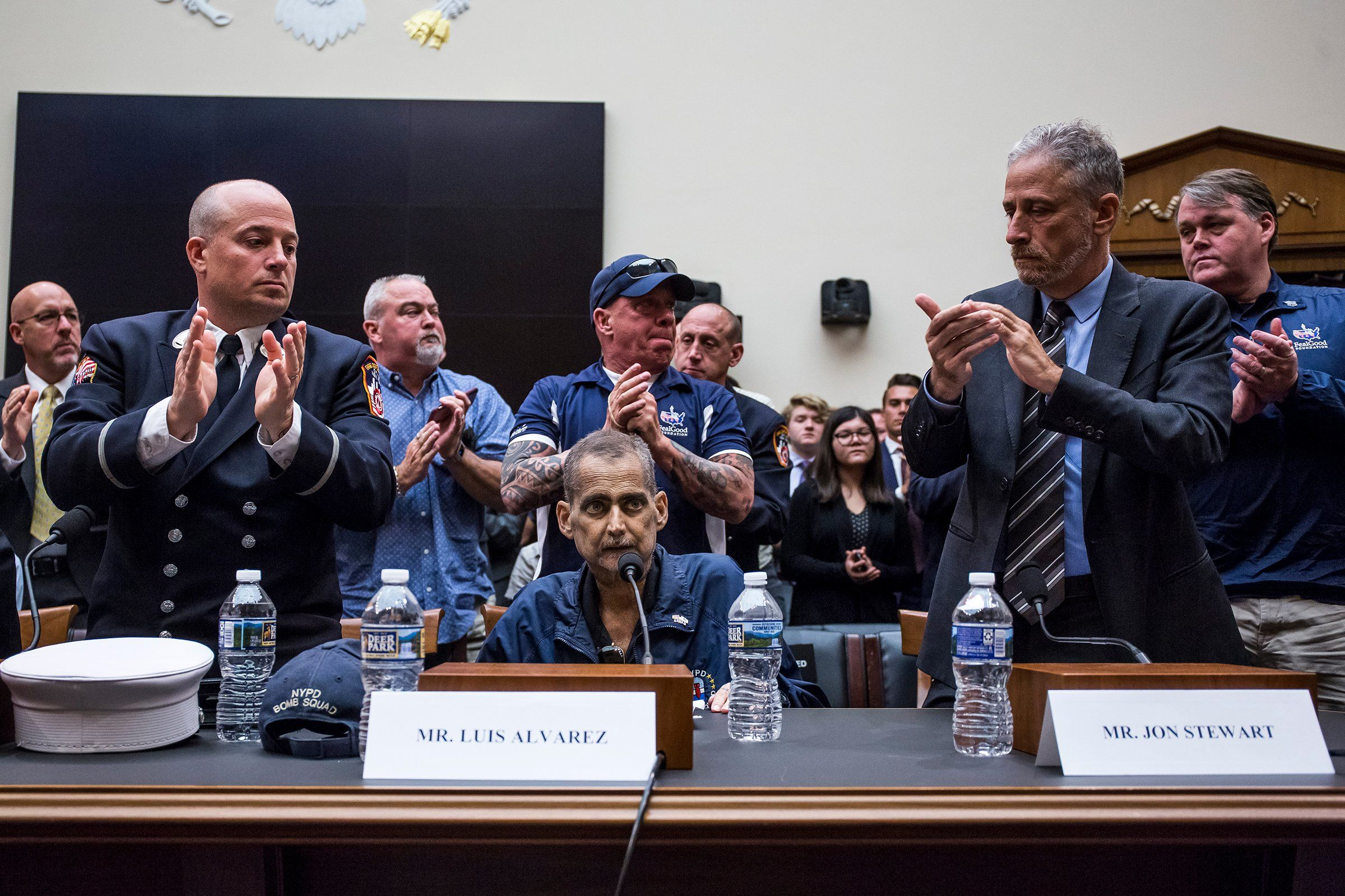 Retired New York Police Department detective and 9/11 responder Luis Alvarez is applauded after testifying during a hearing on reauthorization of the September 11th Victim Compensation Fund in Washington, D.C., on June 11. Among those clapping: Retired Fire Department of New York Lieutenant and 9/11 responder Michael O'Connell, left; John Feal of the FealGood Foundation, center; and former Daily Show host Jon Stewart. In July, Trump signed into law an extension of the fund—through 2092.